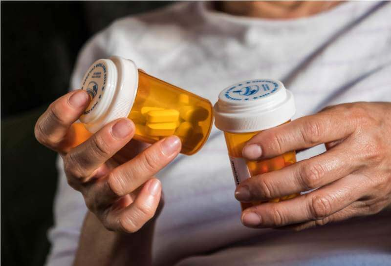 woman-examining-medication-treatment