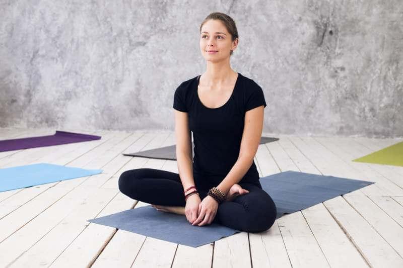 woman-practicing-meditation-at-a-yoga-studio