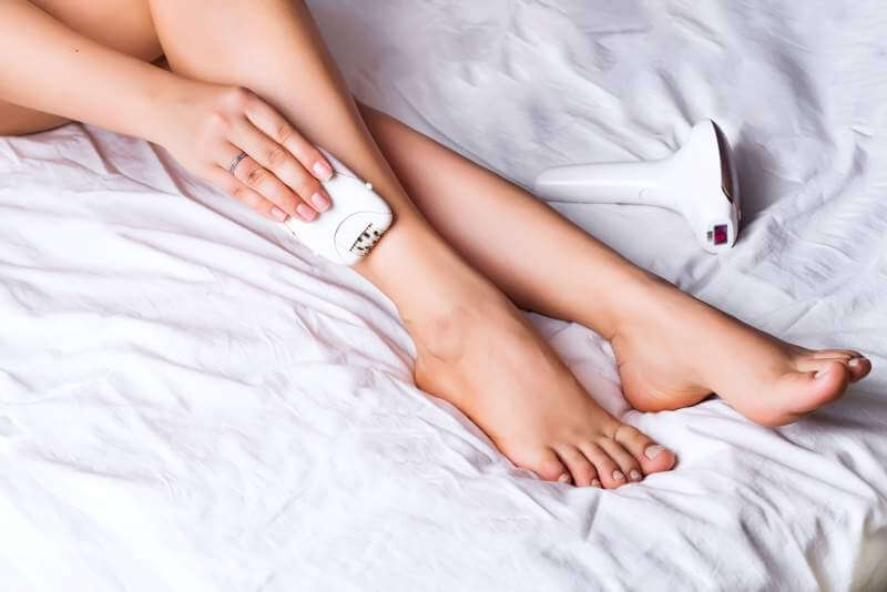 woman-using-laser-epilator-for-hair-removal