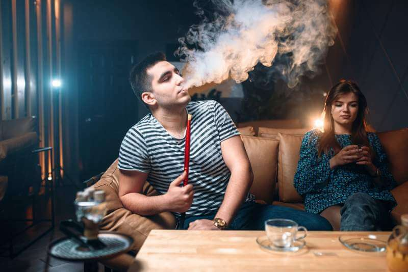 young-couple-relax-and-smoking-hookah
