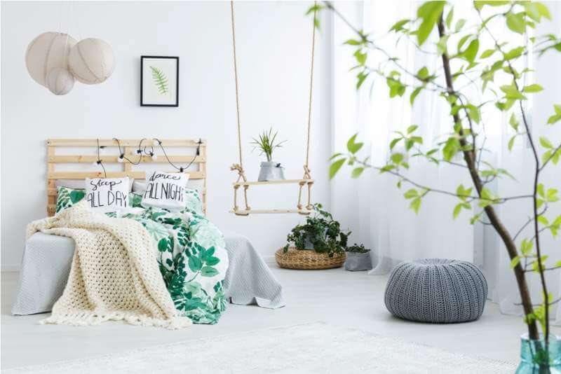 bedroom-with-gray-pouf