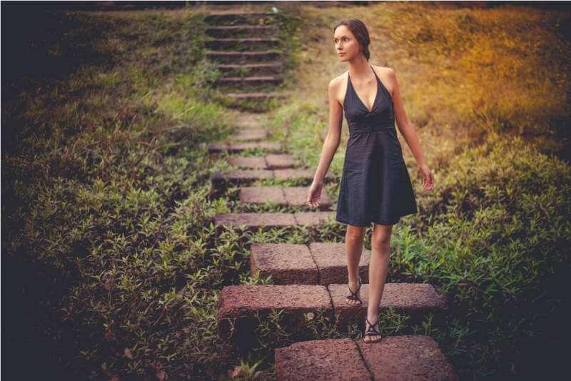 happy-beautiful-young-girl-walking-down