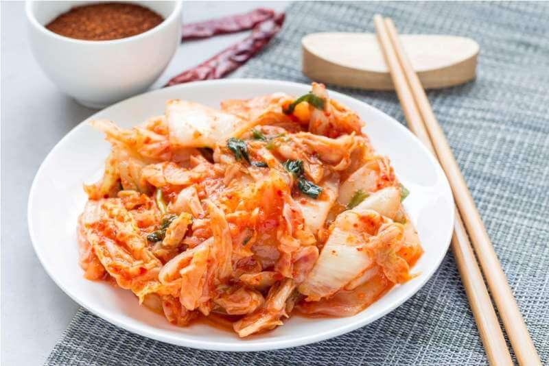 kimchi-cabbage-korean-appetizer-on-white-plate