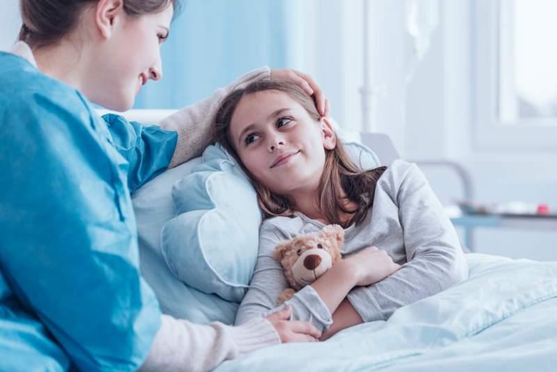 smiling-caregiver-visiting-sick-child