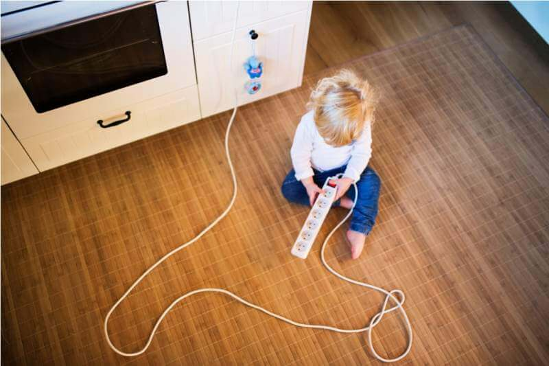 toddler-boy-in-dangerous-situation-at-home-child