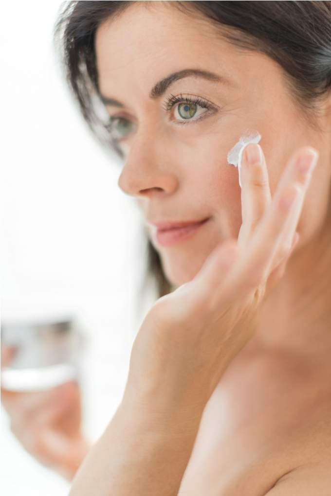woman-in-her-forties-applying-cream