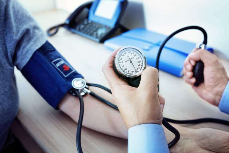doctor-measuring-blood-pressure-of-patient