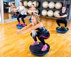 focused-group-training-squats-on-half-ball