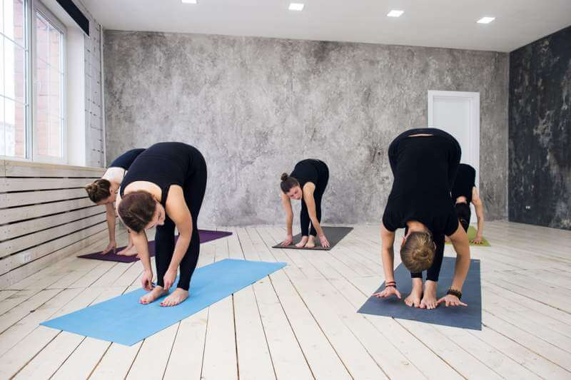 group-doing-yoga-at-the-gym-welcoming-on-yoga