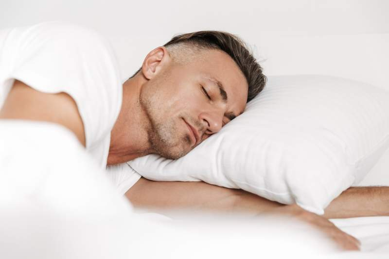 handsome-man-sleeping-in-bed