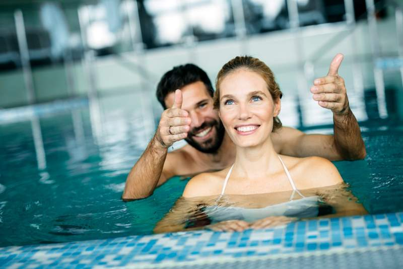 happy-attractive-couple-relaxing-in-swimming-pool