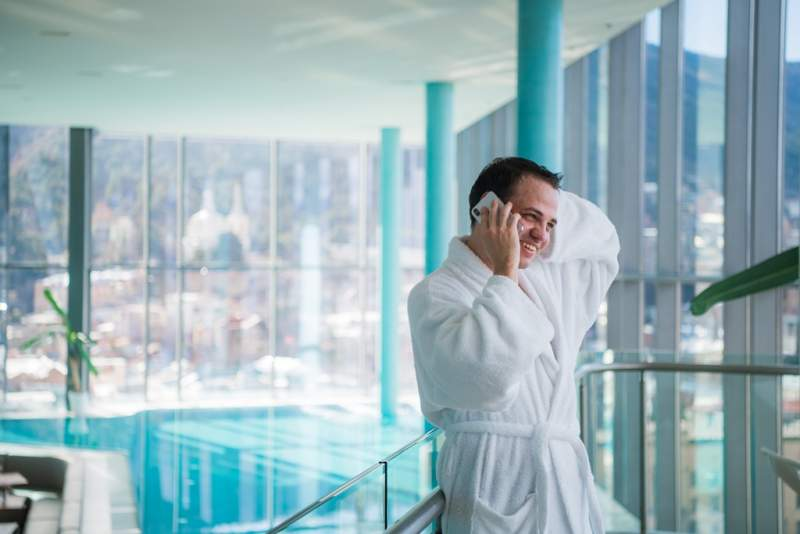 man-use-the-cellphone-at-luxury-hotel-spa