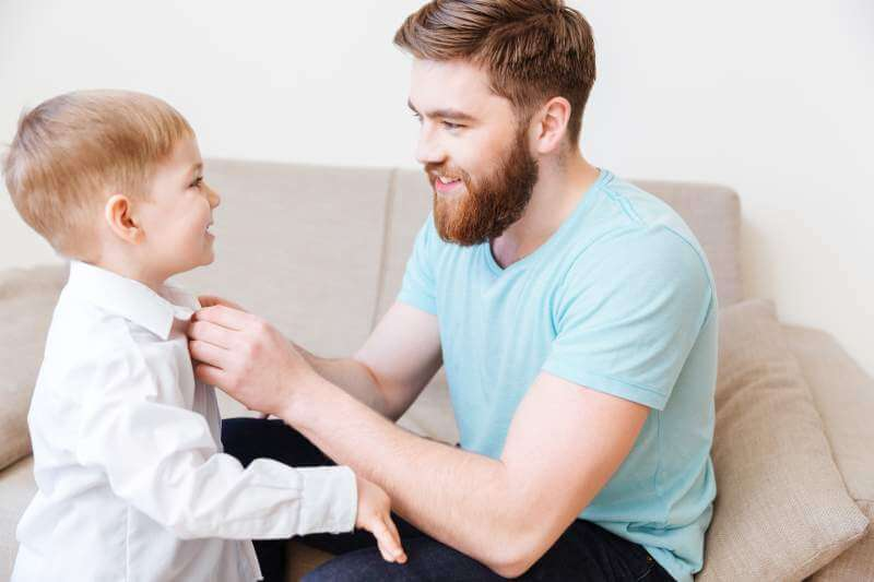 smiling-bearded-young-father-dressing