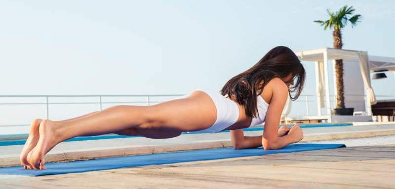 woman-working-out-on-yoga-mat