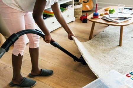 young-teen-girl-vacuuming-up-the-house