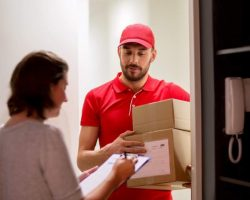 deliveryman-and-customer-with-parcel-boxes