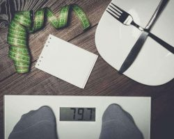 dieting-concept-with-scales-on-the-wooden-floor