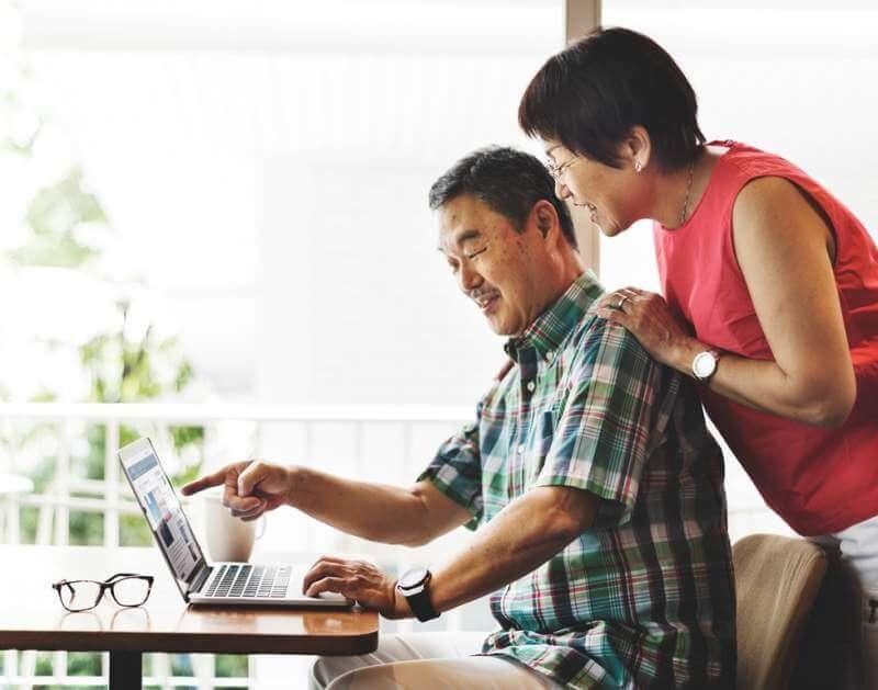 elderly-senior-couple-computer-home