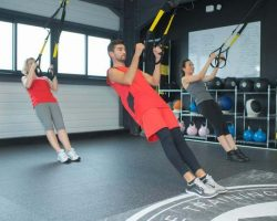 fit-young-people-training-hard-at-the-gym