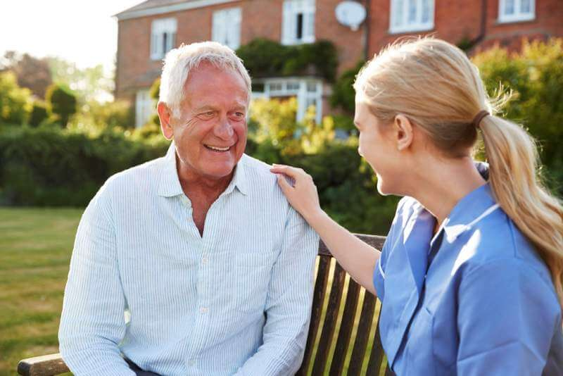 nurse-talking-to-senior-man-in-residential-care