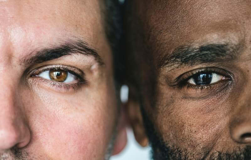two-different-ethnic-men-39-s-eyes-closeup