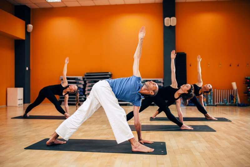 yoga-training-female-group-with-trainer-in-motion