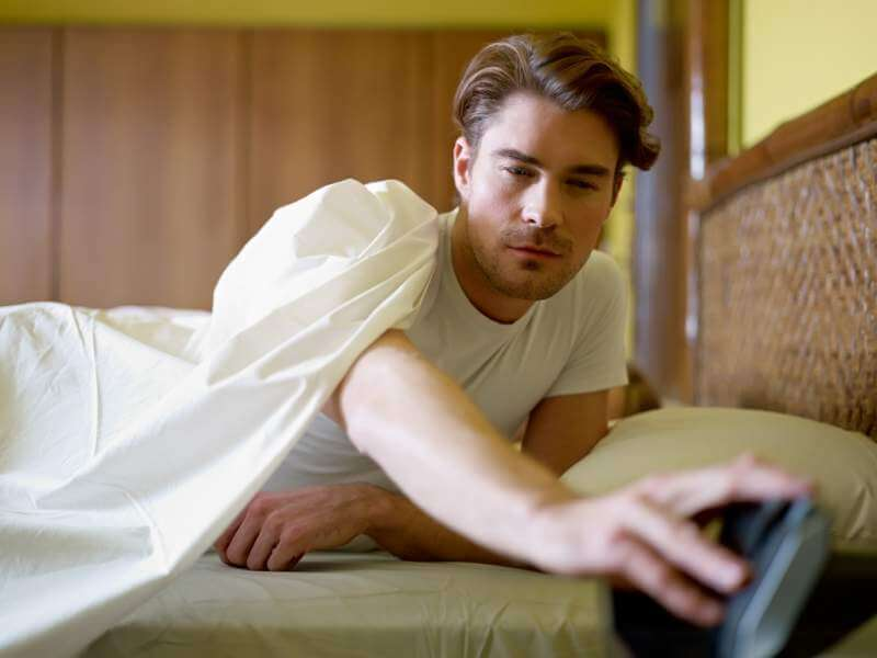 young-adult-man-waking-up-in-the-morning