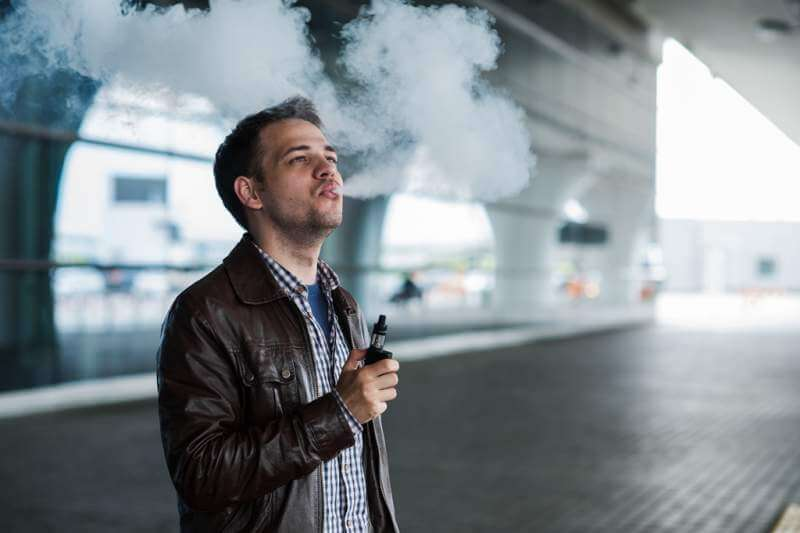 young-traveller-man-smoking-an-electronic