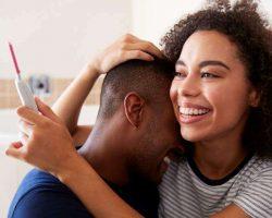 couple-celebrating-positive-home-pregnancy-test
