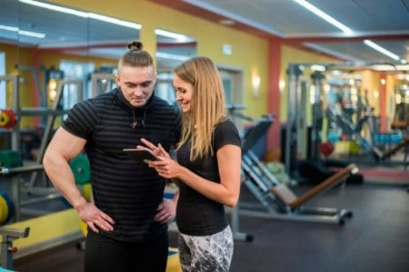 fit-attractive-young-couple-at-a-gym-looking