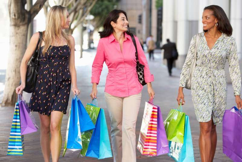 group-of-women-carrying-shopping-bags-on-city
