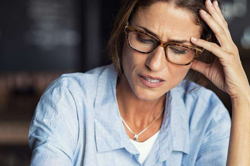 stressed-woman-wearing-eyeglasses