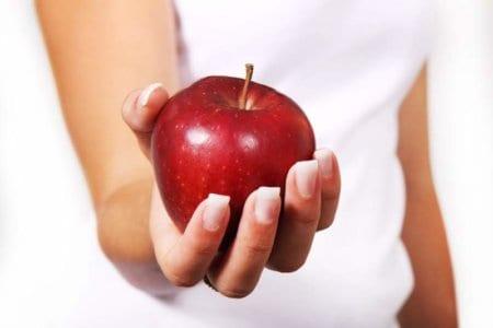 women holding apple