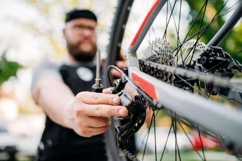 bicycle-mechanic-repair-bike-with-broken-shifter