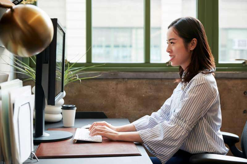 chinese-woman-working-at-a-computer-in-an-office