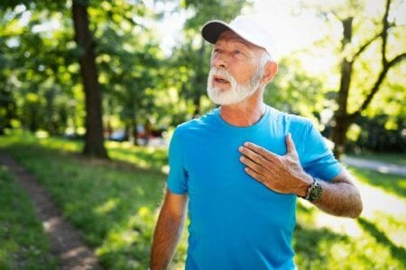 mature-man-exercising-outdoors-to-prevent