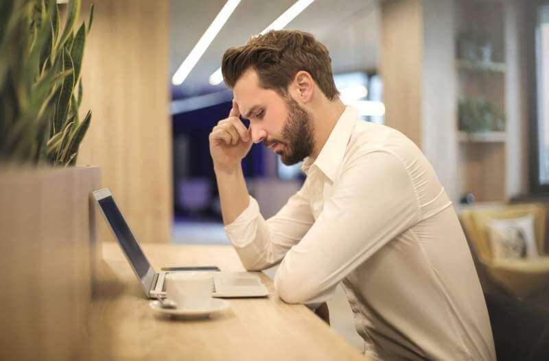 men using laptop stress