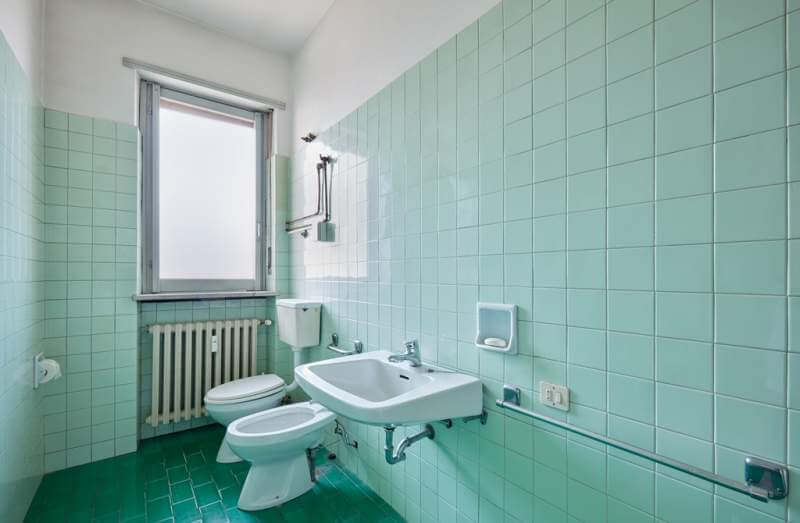 old-bathroom-interior-with-green-tiles