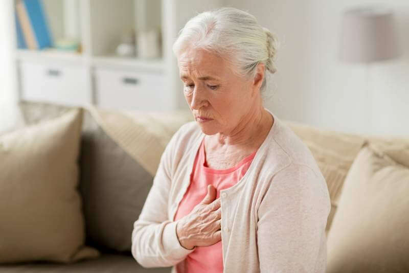 senior-woman-suffering-from-heartache-at-home