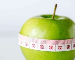 closeup-of-healthy-diet-and-weight-loss-concept