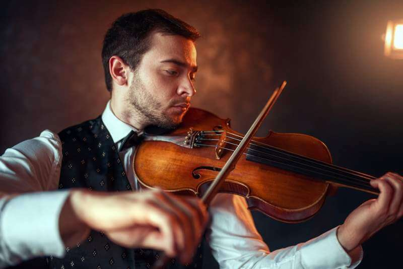 male-fiddler-playing-classical-music-on-violin