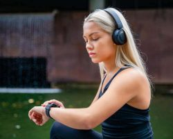 sporty-female-runner-listening-music