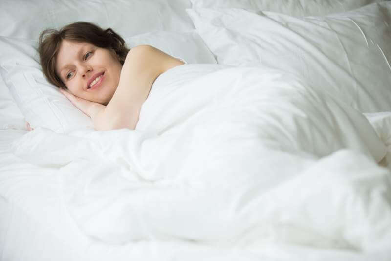 woman-resting-in-bed