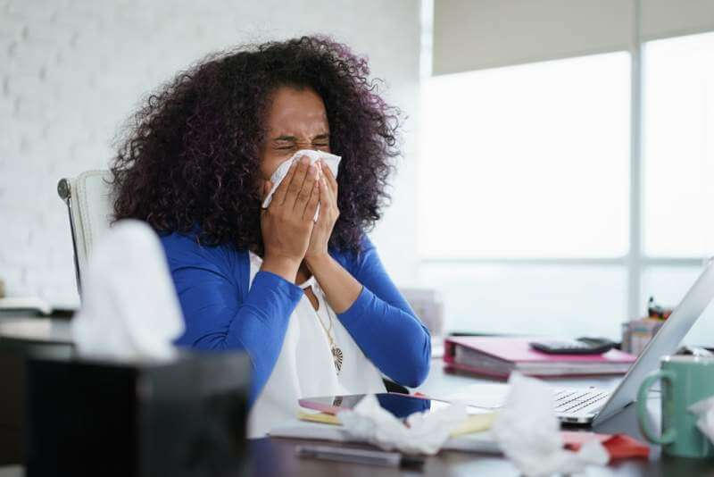 black-woman-working-from-home-and-sneezing