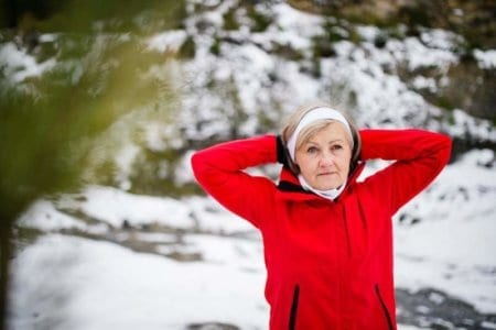 senior-woman-jogging-in-winter-nature