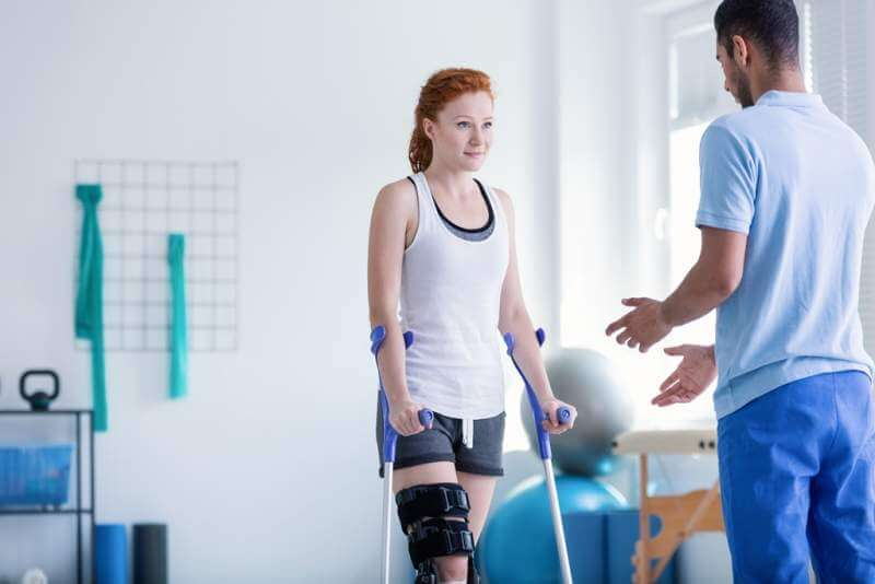 woman-with-crutches-during-rehabilitation
