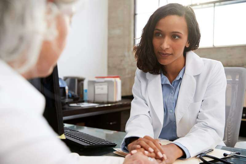 young-female-doctor-in-consultation-with-senior