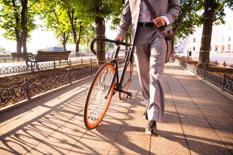 businessman-walking-with-bicycle