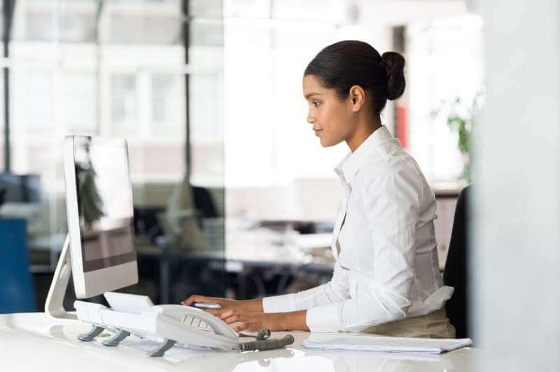 secretary-at-computer-desk