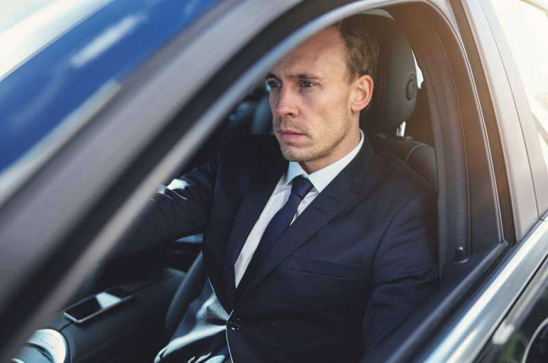 serious-businessman-driving-his-black-stylish-car